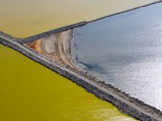 In the southern reaches of San Francisco Bay, ponds created to produce salt by evaporation take on other-wordly colours, thanks to blooms of salt-tolerant microbes.