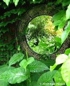 Tuck a mirror into a shady nook in your garden to create a magic window. by iris-flower