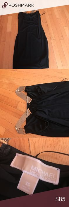 Micheal Kors black dress( NEW) Cute black dress with golden straps , very beautiful and only worn once(no stains/rips/tears)... feel free to offer KORS Michael Kors Dresses Mini