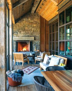 Weathered logs and stone join with sleek Midcentury Modern furnishings in this Wyoming abode.