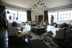 Interior designer Michelle Niday slipcovered the sofas in white denim. The two Bergere chairs in the distance are 18th century pieces covere...