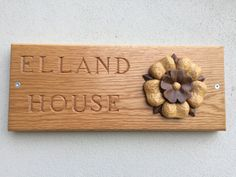 Elland House hand carved by T. Bespoke hand made house signs.