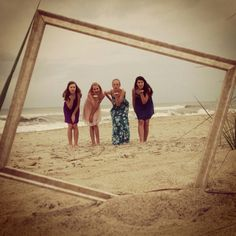 I like the idea of sticking a frame in the sand and taking a picture through it
