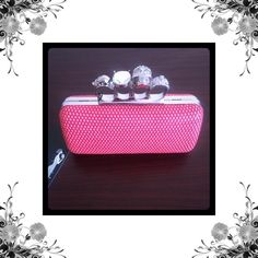 Small Knuckle Ring Clutch Red and silver knuckle ring clutch. This clutch rocks! Chain strap included. Brand new with tags. Bundle for discounts! Thank you for looking! Ever Pretty Bags Clutches & Wristlets