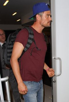 Couple strip: Her husband Josh Duhamel was also spotted at the international airport