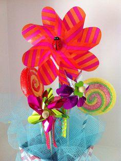 Lollipops and pinwheels centerpiece by GlitterBlingFun on Etsy, $33.00