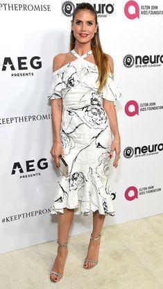 Heidi Klum in a pattern white off-the-shoulder dress