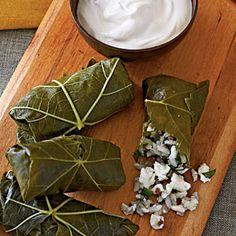 Stuffed Grape Leaves - This classic Mediterranean dish makes a great party hors d'oeuvre. Brined flavor comes from both the grape leaves and the salty feta cheese. Entree Recipes, Side Dish Recipes, Appetizer Recipes, Vegetarian Recipes, Cooking Recipes, Diet Recipes, Healthy Recipes, Healthy Appetizers, Appetizers For Party