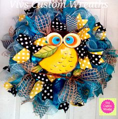 Beautiful large Owl is centered in this blue deco mesh. This wreath has several ribbon types including polka dots and chevron. This wreath could be used indoors as wall decor or go on the front door. Everyone will enjoy viewing this georgous wreath. Ready to ship