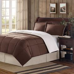 "Woolrich Mink/Berber Comforter Set - Chocolate - Full/Queen by Woolrich. $69.99. Patten: Solid. Set Includes: 1 Comforter, 2 Shams. For ultimate comfort and warmth, you can't go wrong with the Woolrich Mink Berber Comforter mini set. Material: Polyester. Size: Full/Queen: 88x90""/20x26+2""(2). For ultimate comfort and warmth, you can't go wrong with the Woolrich Mink Berber Comforter mini set. One side is super soft and cuddly berber, and the other side is a beautiful, soft, plush ..."