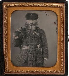 c 1850-60s, Daguerreotype portrait of a mountain man, possibly a Northwoodsman, armed with a Billinghurst percussion revolving rifle, hatchet and large knife