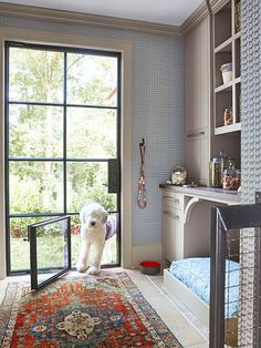 Non-negotiable Dog Room Decor Essentials From dog bowls, pet beds, toys & tech, to pet gates, doggy doors & more. Check out our dog room decor wrap-up for all the best dog room decorating ideas. Built In Dog Bed, Dog Room Decor, Dog Spaces, Pet Gate, Animal Room, Dog Rooms, Rooms For Dogs, Pet Beds, Mudroom