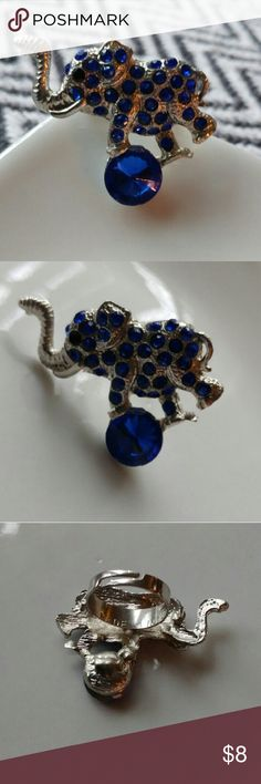 Silver elephant ring with blue rhinestones Adjustable silver elephant ring with blue rhinestones. Size fits most. Great condition, Never worn. Fun statement piece! Jewelry Rings
