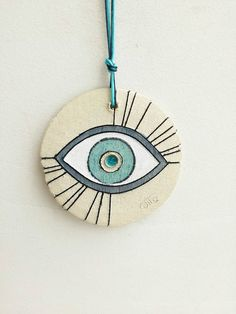 Ceramic eye wall hanging stoneware clay eye in white blue Roseville Pottery, Ceramic Pottery, Ceramic Art, Diy Clay, Clay Crafts, Color Me Mine, Pottery Painting Designs, Ceramic Jewelry, Stoneware Clay