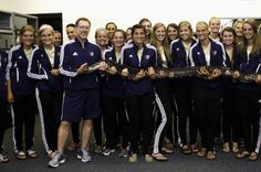 The Bruin women's soccer team poses with one of Coach Chris Carmichael's pythons.  Photo: Amy Roukes