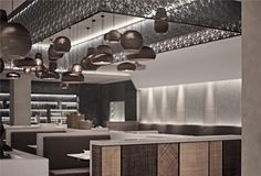 """The concept """"comfort"""" drives the overall layout of the restaurant. In order to meet the demands of small gatherings, the lighting design creates a private cozy spatial feeling by using accent lighting strategy."""