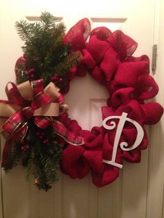 Red burlap wreath with pine, plaid bow and initial  https://www.facebook.com/pages/GGs-Decos/450556885063473