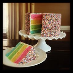 The outside of my wedding cake will look different...but I TOTALLY want a rainbow cake.