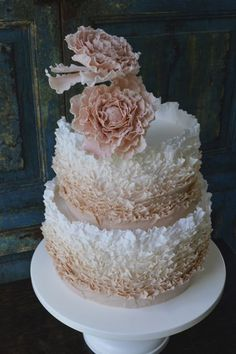 Ruffled ombre wedding cake with 2 peonies