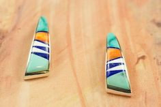 Native American Jewelry  Genuine Sleeping Beauty Turquoise, Spiny Oyster Shell, Magnesite and Blue Lapis inlaid between ribbons of Sterling Silver. Beautiful Post Earrings Designed by Navajo Artist Calvin Begay.