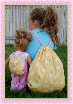 Free pattern from Dream. Dress. Play. for matching backpacks for a little girl and her 18-in. doll or stuffed animal.