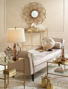 Living room in a light color palette with a daybed and brass side, coffee and console tables