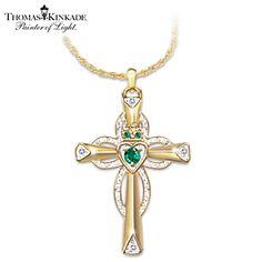 Beautiful diamond and emerald claddagh cross designed by Thomas Kinkade