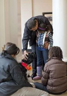 Barack Obama The White House releases photos of the 'First Dog' named 'Bo. The Obama's dog 'Bo' was recommended by Senator M. Edward Kennedy who has three Porties. Sasha Obama and Malia Obama met their new Portuguese Water Dog puppy at the White House. The six-month-old puppy arrived at the White House on April 14th 2009.