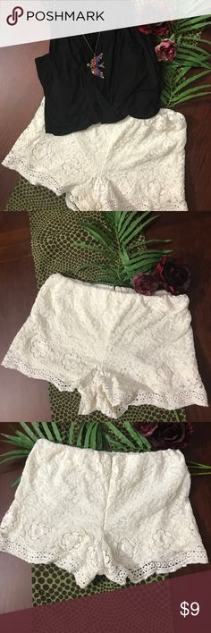 Ivory Lace Shorts with Liner size Large Great shorts to pair with a solid top, cute sandals and some sparkly jewelry.  Perfect for warm nights.  Shorts fit like a 10/12. Shorts