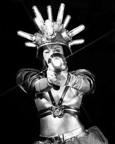 Electric Valkyrie fires her ray gun after taking careful aim. Recorded on b/w film on a Crown Graphic camera and lens. photo by Scott Speck Space Girl, Space Age, Vintage Space, Vintage Photos, Vintage Toys, Futurama, Comics Illustration, Space Fashion, Atomic Age