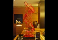A unique design of spiraling red gloriosa lilies for Maison du Chocolat - By Flowers of the World Gloriosa Lily, Event Decor, Floral Design, Planters, Christmas Tree, Contemporary, Lilies, Holiday Decor, World