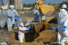 #Japan Ministry of Defense workers remove a drum Jan. 28, 2014, from a soccer field next to Amelia Earhart Intermediate School on #Kadena Air Base where 22 dioxin- and herbicide-laced drums were unearthed last summer. (TRAVIS J. TRITTEN/STARS AND STRIPES) #miiltary #USAirForce #AirForce