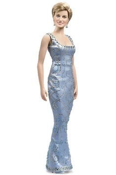 Princess Diana - Blue Beaded Silk Gown Vinyl Portrait Doll by Franklin Mint  From Shy Di to trendsetter, Princess Diana's emergence as a fashionista is perhaps best embodied by the dazzling designer gown re-created for this dazzling vinyl portrait doll. A galaxy of hand-applied beads glitters on a stylish form-fitting frock. Further emphasizing Diana's new attitude…a boyishly short coif providing a full view of her elegantly styled, faceted earrings.