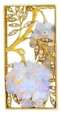 An Art Nouveau 'Wisteria' opal and diamond panel brooch, attributed to René Lalique, circa 1900. Carved opal wisteria frutescens on gold branches with draping old mine-cut diamond foliage, within a rectangular, curved frame. #Lalique #ArtNouveau #brooch