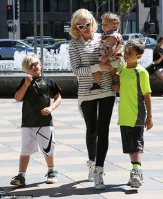 Cute: Proving what a devoted parent she is, Gwen Stefani was spotted enjoying a family day out with her sons Kingston, Zuma, and Apollo at the Cheesecake Factory on Saturday afternoon