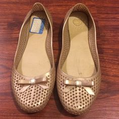 Gold perforated flats Gold perforated flats with bow detail, flat is jelly material, worn once or twice, size 8. Reasonable offer will be accepted! Shoes Flats & Loafers