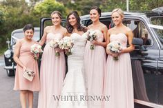 Bridesmaids wearing the Making History Dress in Peach. Junior bridesmaid wearing the Charlie Dress in Apricot.