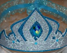 See 6 Best Images of Printable Frozen Tiara. Frozen Elsa Crown Printable Free Printable Frozen Elsa Crown Disney Frozen Crown Tiara Elsa Crown Template Frozen Elsa Crown and Wand Disney Frozen Party, Elsa Frozen, Frozen Fever Party, Frozen Party Favors, Frozen Theme, Frozen Princess, Princess Bubblegum, Elsa Birthday Party, Birthday Gifts