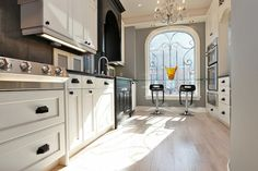 Glamorous Victorian in Yorkville: A tempered glass breakfast bar in front of a street-facing window brings the espresso bar experience home
