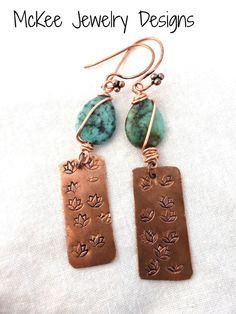 Green turquoise wire wrapped and lotus flower charm copper earrings.