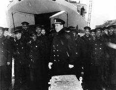 Commissioning Ceremony of destroyer escort USS Mason (the first US Navy ship with a predominately African-American crew), Boston Navy Yard, 20 Mar 1944; Lt Cmdr Blackford in center and LST in background. (US National Archives)