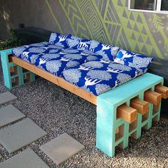 You don't have to be handy with a hammer to build a backyard bench. In fact, as Lena of Simple Living shows us, all you need are some cinder blocks, 4x4 wooden posts, and concrete adhesive. Top with store-bought outdoor deep seating cushions or DIY a set in your favorite pattern.