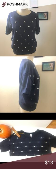 """Rhinestone Studded Short Sleeve Navy Sweater Cute JCP navy blue sweater with white rhinestone detail at front. Soft comfortable fabric, crew neckline. Size Medium Chest 21"""" across, Sweep 15"""" across, Length 23 1/2"""", sleeve length from shoulder 7"""". jcpenney Sweaters Crew & Scoop Necks"""