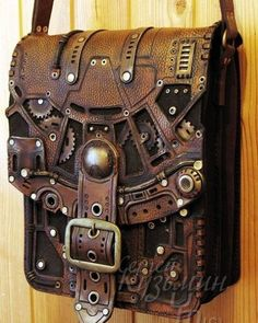"geekygeekweek: "" Stunning Steampunk Leather Bags And Books These bags and books are the work of Russian leatherworker and throat singer Serguei Kooc. He's created incredibly detailed Steampunk bags and books with lots of brass accents. Costume Steampunk, Viktorianischer Steampunk, Design Steampunk, Steampunk Couture, Steampunk Clothing, Steampunk Fashion, Gothic Fashion, Steampunk Outfits, Steampunk Necklace"