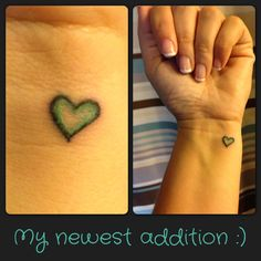 My newest tattoo. Small heart on my wrist with Tiffany blue on the inside. <3