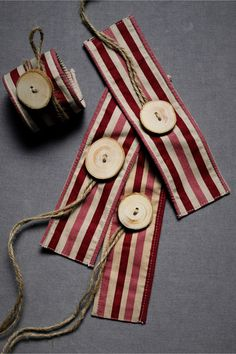These super cute napkin rings look pretty DIY-able. Use wide ribbon instead of fabric, and they become no-sew.