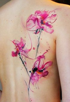 Abstract Flower Watercolor tattoo on back for girl