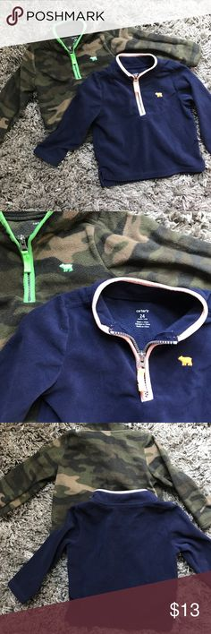 Toddler Boys Fleece Sweaters 24 months Carter's 2 Toddler Boys Fleece Sweaters Size 24 months.  1 camouflage and 1 navy with half zip front.  Thinner Fleece material for layering.  Not bulky. Carter's Shirts & Tops Sweaters