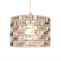 Made with a metal frame design coated in a chrome finish, this cylinder light pendant is embellished with sophisticated crystals varying in sizes....