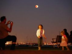 Melbourne, Australia - The moon is turned an orange-red colour creating a 'Blood Moon', as a lunar eclipse can be seen in the clear skies above the Williamstown suburb of Melbourne  on April 15, 2014.